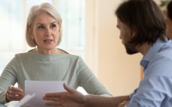 Mature woman discusses her will with her son